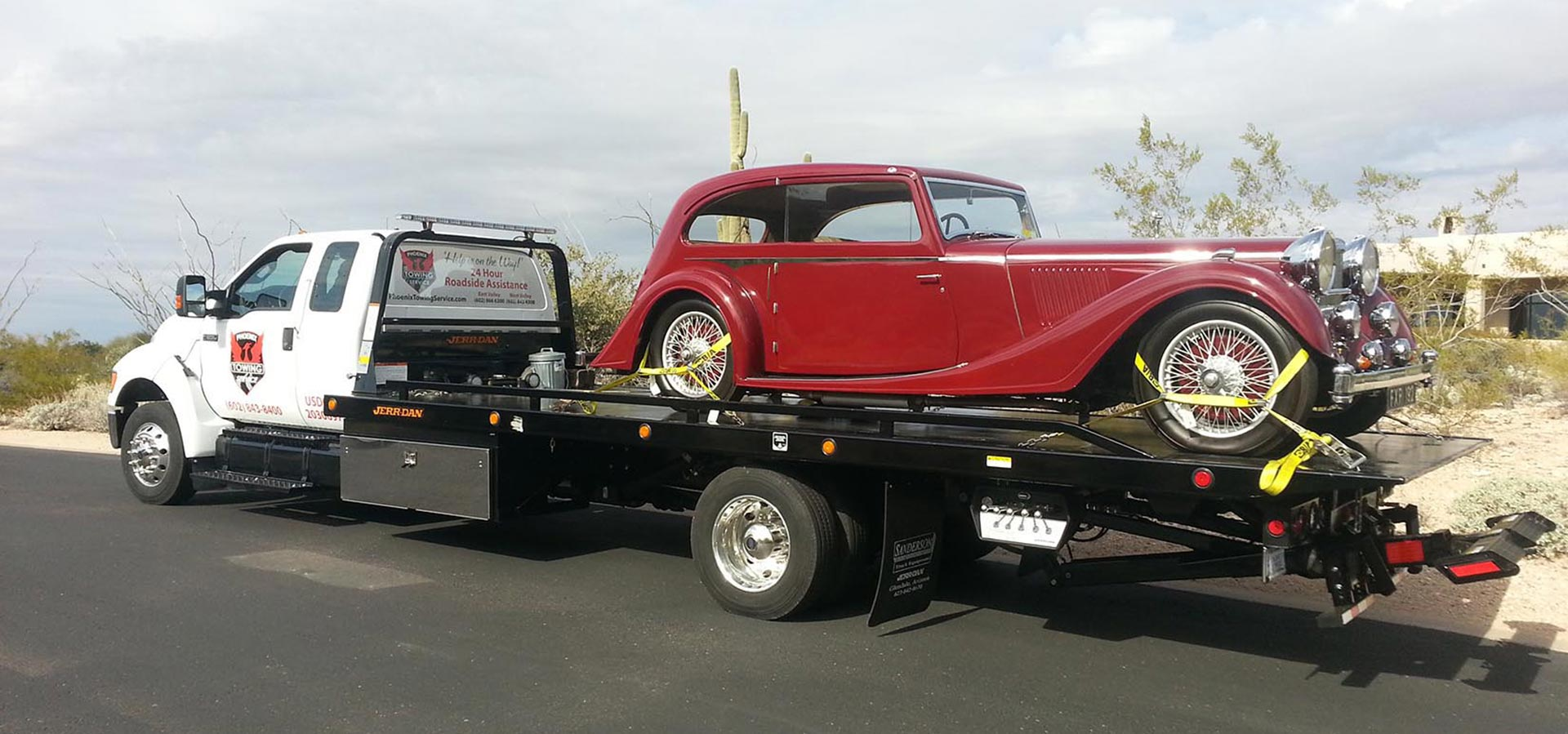 Photo of Phoenix Towing Service truck towing a exotic red vintage car.