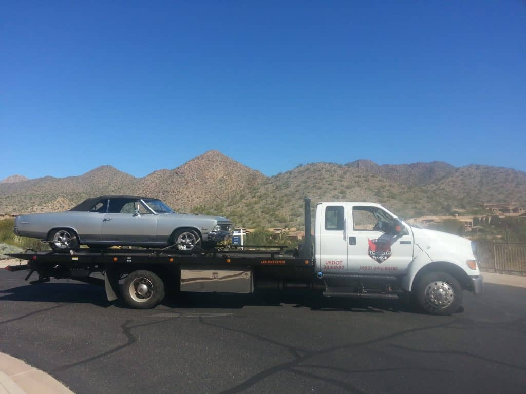 A photo of Silver Chevy being towed