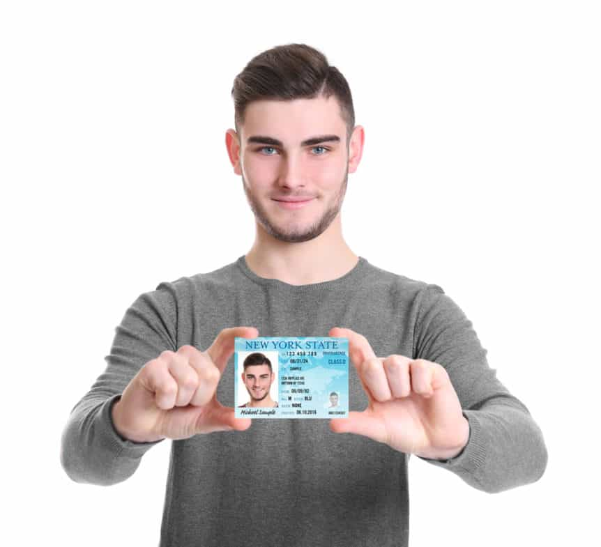 young man showing his Driver's Licence against a white background