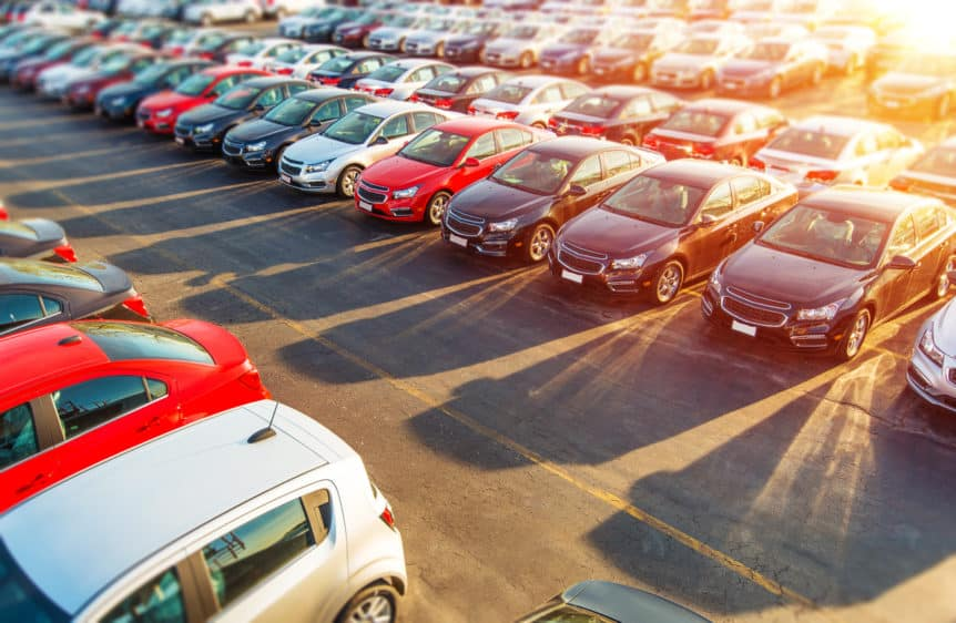 Dealer New Cars Stock. Colorful Brand New Compact Vehicles For Sale Awaiting on the Dealer Parking Lot. Car Market Business Concept.