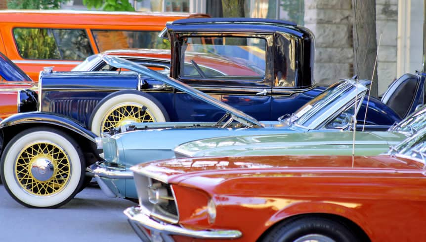 Classic cars parked along street at a car show in Phoenix.