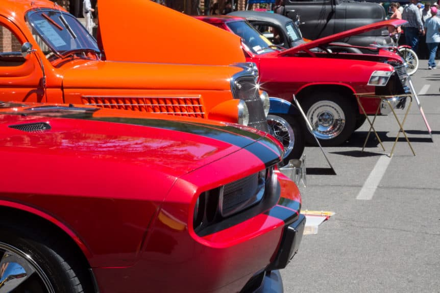 Cars lined up at a car show