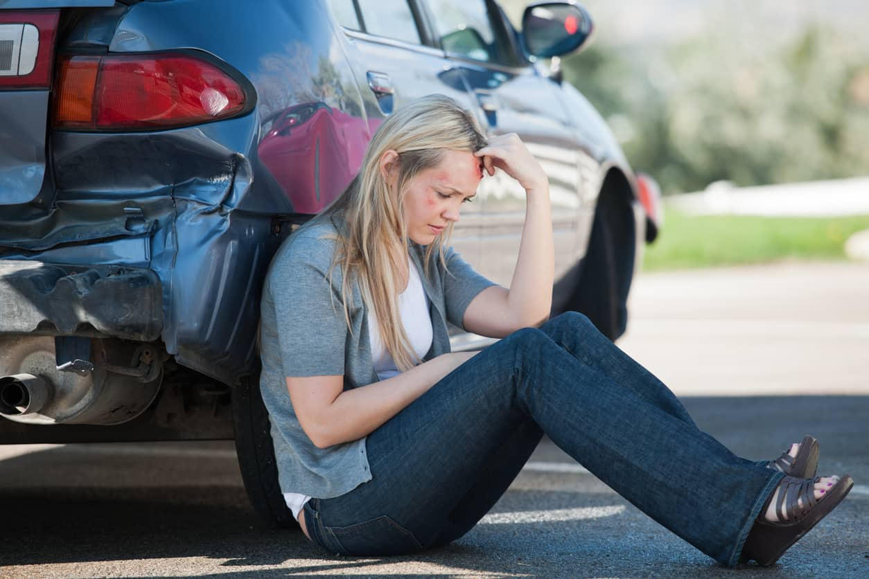 Woman-calling-police-and-ambulance-afte-accident What You Should Do While You Wait For A Tow Truck?