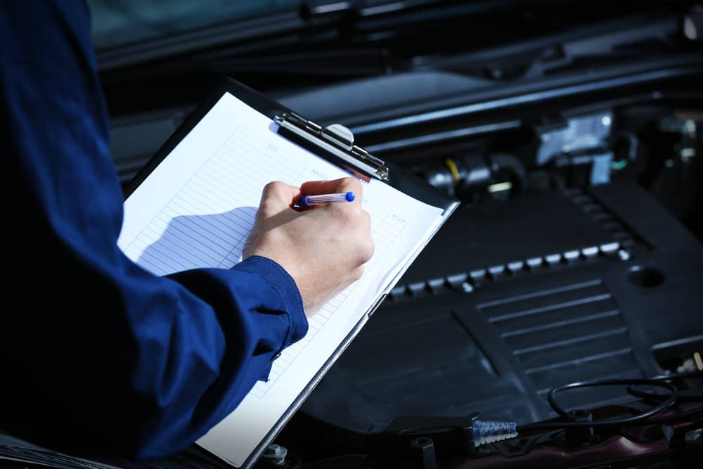 Picture of a man signing towing service papers