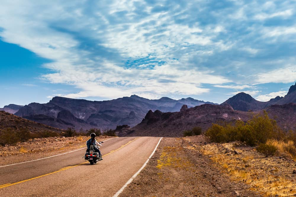 arizona-road-with-biker-photo Best Tires For Driving in Arizona