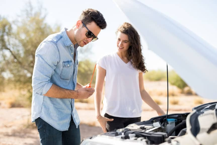 Couple on road trip with broken down car